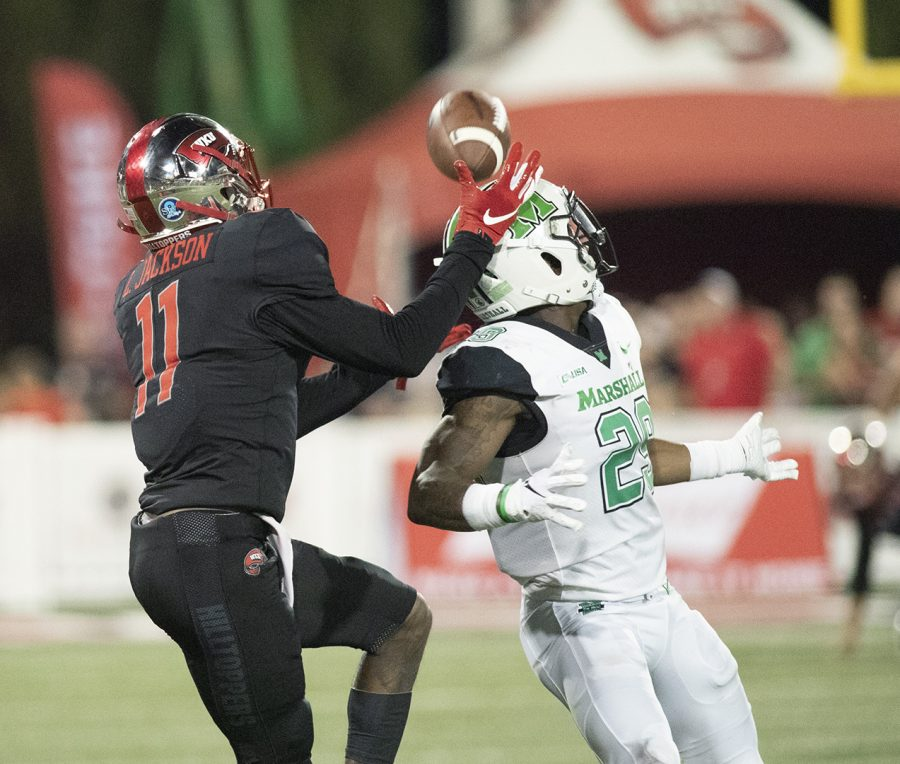 Safety Malik Gant(22) defends WKU's Lucky Jackson(11) from receiving a little air mail in the battle of Bowling Greens on