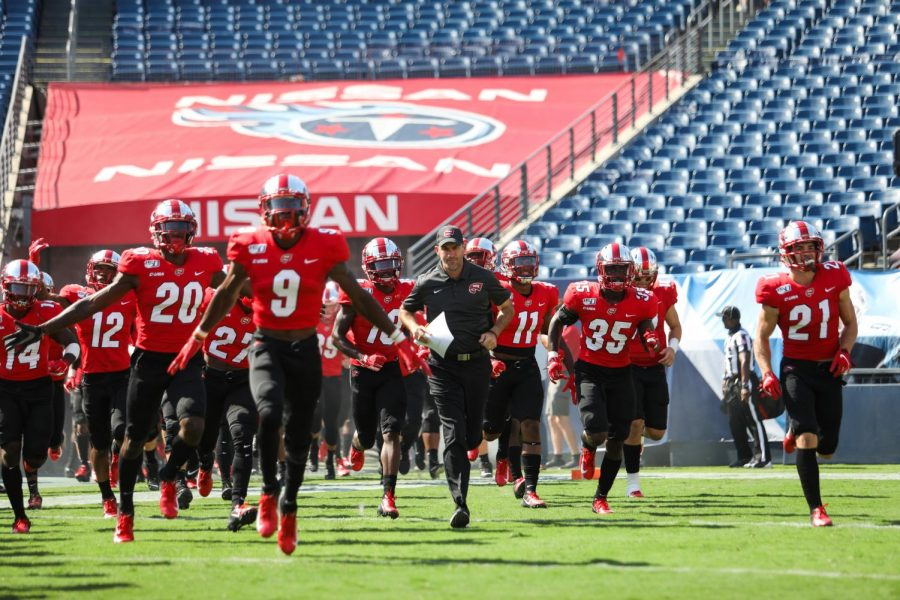 WKU+head+coach+Tyson+Helton+leads+his+squad+on+to+the+field+to+play+in-state+adversary%2C+the+Louisville+Cardinals+on+September+14%2C+2019+at+Nissan+Stadium.+Louisville+won+38-21.