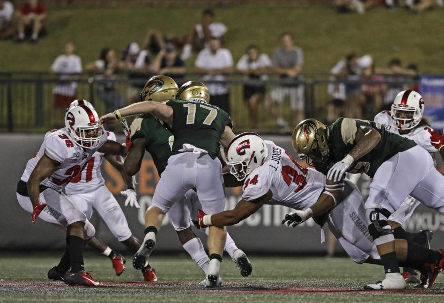 Defensive-lineman Juwuan Jones (34) tackles UAB quarterback Tyler Johnston III (17) during the game against UAB at Houcens-Smith Stadium. WKU sacked Johnston three times during the game.