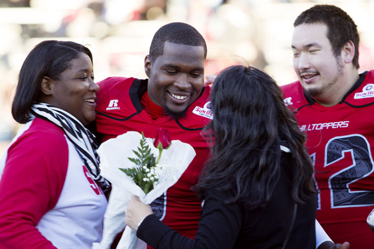 Western Kentucky Hilltoppers running back Antonio Andrews and fullback Nick Baisch (42) stand with family during senior day ceremonies before Saturdays game against Arkansas State. Western Kentucky lead 20-14 at the half.