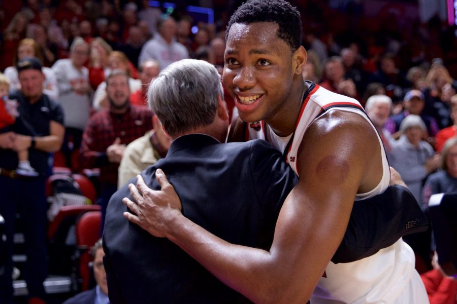 Charles Bassey (23) embraces head coach Rick Stansbury after defeating 15th-ranked Wisconsin in Diddle Arena Dec. 29 in Bowling Green.