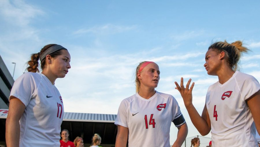 Christina Bragado (left) Kaylyn Bryant (center) and Lyric Schmidt (right) deliberate during halftime of Sundays exhibition match against Austin Peay.