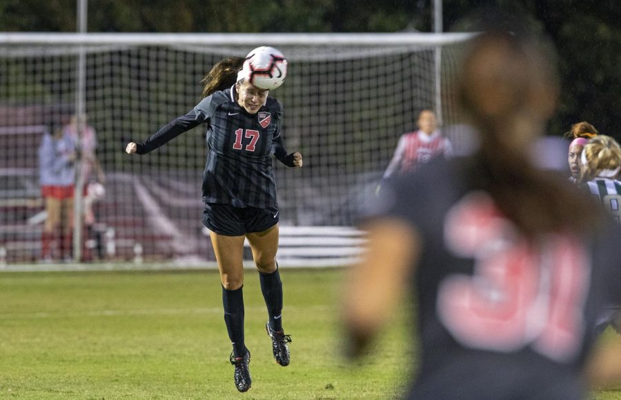 WKU senior Christina Bragado (17) heads the ball against UAB during the first half of the game at the WKU Soccer Complex on Friday, Aug 26, 2019.