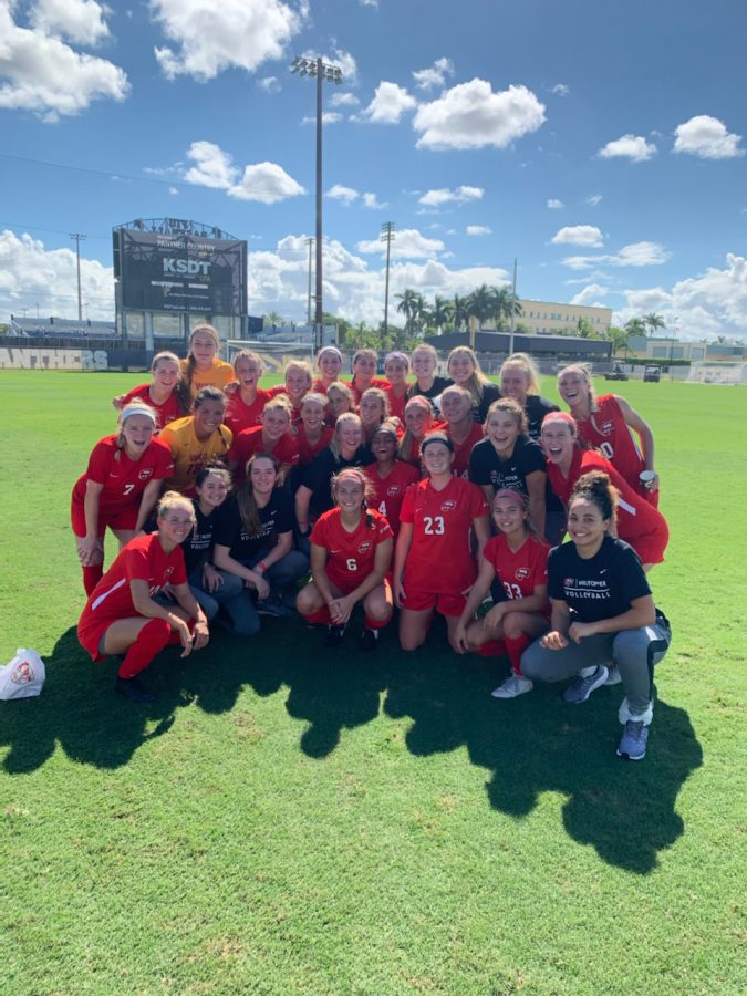Members of the WKU volleyball and soccer teams pose for a group picture at FIU Soccer Stadium after both programs secured milestone victories in Miami on Oct. 13, 2019.