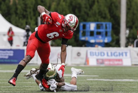 Joshua Simon (6) of Western Kentucky University's maneuvered away from Jacione Fugate (1) of the Charlotte 49ers at the game on Saturday, Oct. 19, 2019, in Houchens-Smith Stadium, Bowling Green, Ky. Simon recovered and continued running towards the endzone.