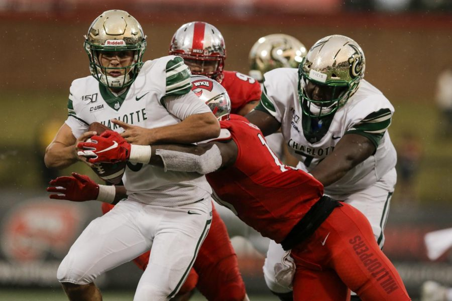 Chris Reynolds (3) of the Charlotte 49ers guarded the ball from DeAngelo Malone (10) of Western Kentucky University's Hilltoppers during their on Saturday, Oct. 19, 2019, in Houchens-Smith Stadium, Bowling Green, Ky.