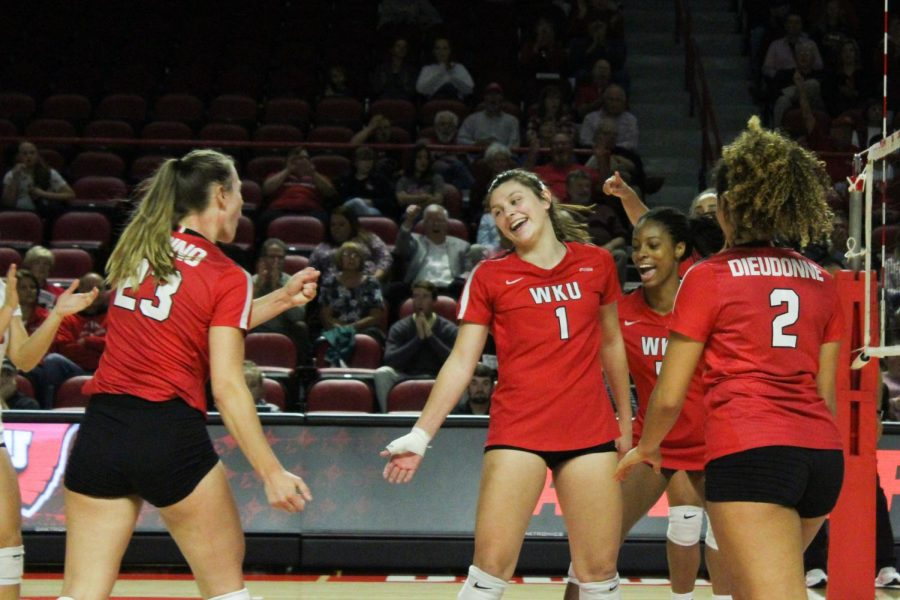 The Lady Toppers celebrate a point scored by freshman Paige Briggs (1) during Sunday's game in Diddle Arena. Briggs had a total of 10 kills, five blocks, five digs, one ace and ended the game with a .320 hitting percentage.