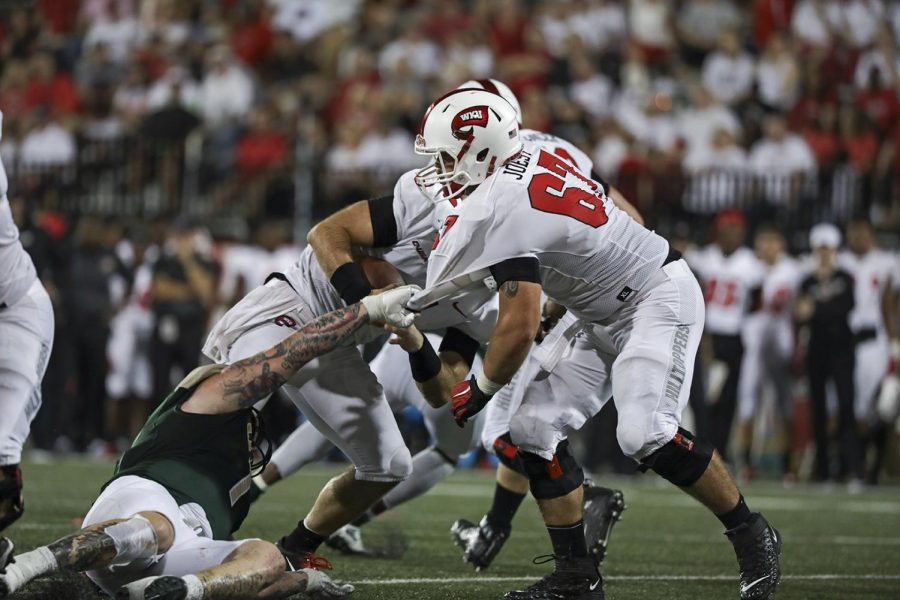 WKU+offensive+lineman+Seth+Joest+%2867%29+jersey+is+grabbed+by+a+UAB+player+during+the+game+at+Houcens-Smith+Stadium.+WKU+won+20-13.