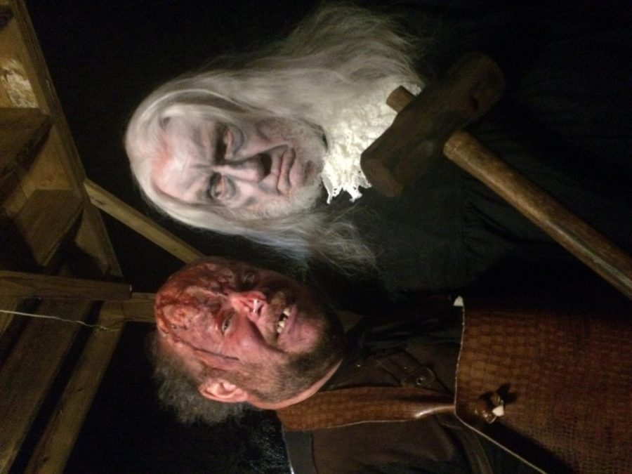WKU Sociology and Criminology professor Craig Taylor (right) poses with a coworker at Raven's Cross Haunted Village in Cave City.