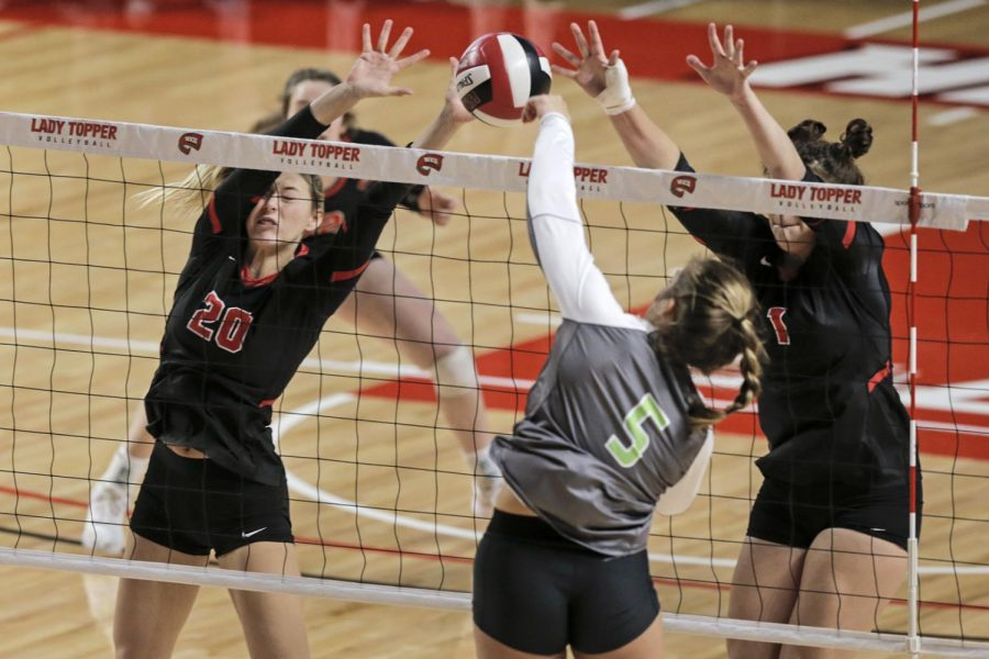 WKU sophomore Katie Isenbarger (20) and freshman Paige Briggs (1) attempt to block a spike from UAB junior Abby Carlile (5) during the WKU's senior day game against the UAB Blazers at E.A. Diddle Arena on Saturday, Nov. 16, 2019. WKU swept UAB 3-0 to finish the regular season with a record of 28 wins and one loss.