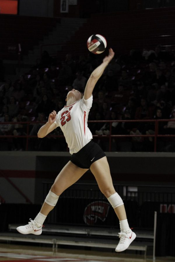 Senior Sophia Cerino (23) lunges skyward to serve during the Lady Toppers' match against Conference USA opponent Louisiana Tech in Diddle Arena on Nov. 14, 2019. The Lady Toppers swept the Lady Techsters, 3-0.