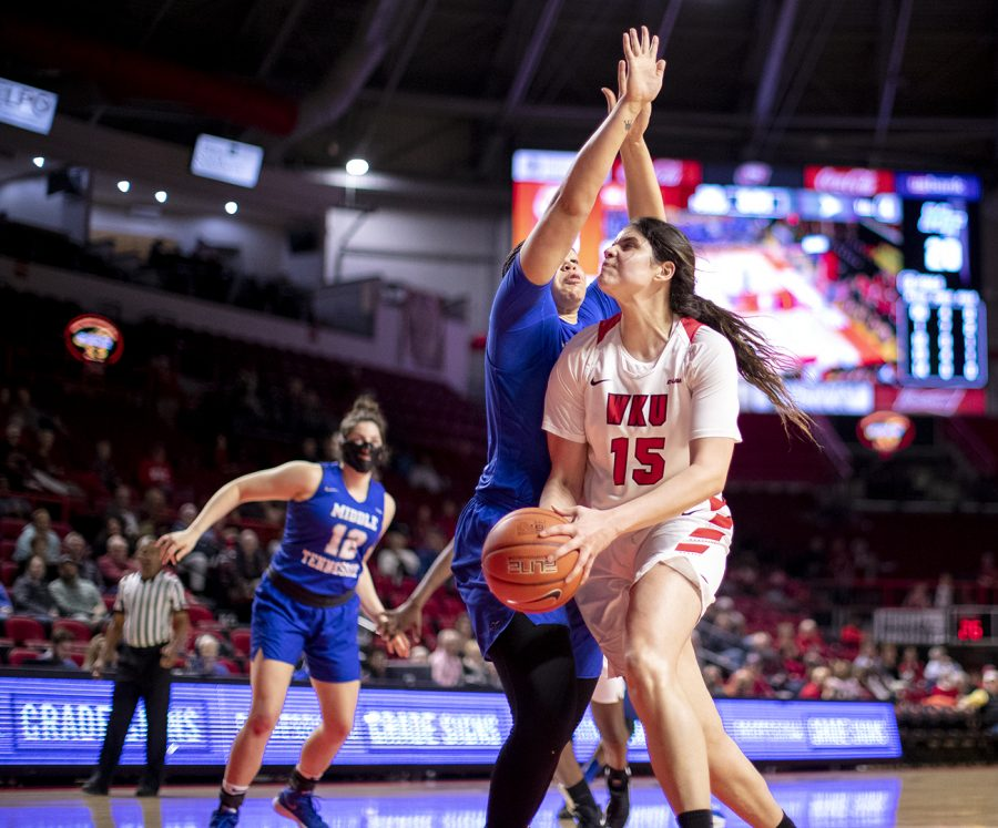 WKU Ladytopper Raneem Elgedawy (15) drives through the key looking to put the ball into the hole past Middle Tennessee State University defender Alex Johnson at E.A. Diddle Arena March 7 in Bowling Green. Elgedawy helped the Ladytoppers best the Lady Raiders 67-56 with 14 points, 8 rebounds and 2 assists.