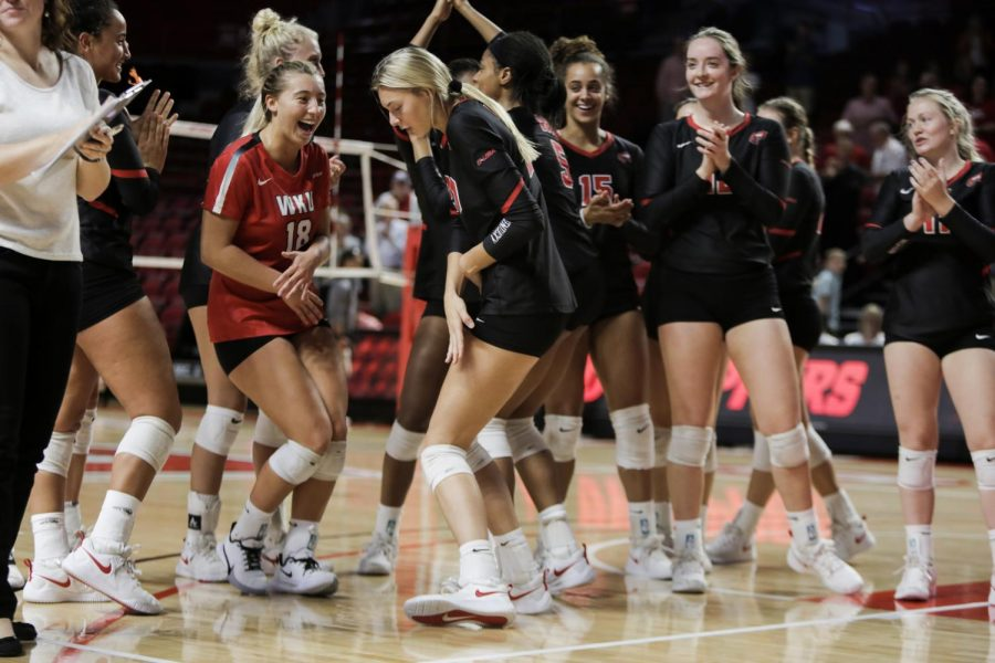 WKU%E2%80%99s+Logan+Kael+%2818%29+and+Katie+Isenbarger+%2820%29+celebrate+a+3-0+victory+over+Marshall+on+October+6%2C+2019+in+Diddle+Arena.