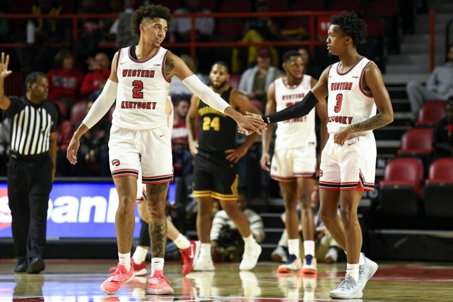 WKU%E2%80%99s+Jared+Savage+%282%29+high+fives+Jordan+Rawls+%283%29+during+the+exhibition+basketball+game+between+Kentucky+State+and+WKU+in+Diddle+Arena+on+November+2%2C+2019.+WKU+won+85-45.