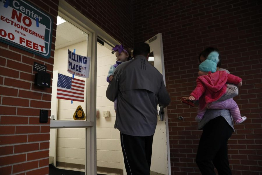 Lauren and Brian Griffing take their daughters Laine, 2, and Evelyn, 7 months, to the polls before work. The Griffings are both teachers and are excited about their vote, Lauren said.