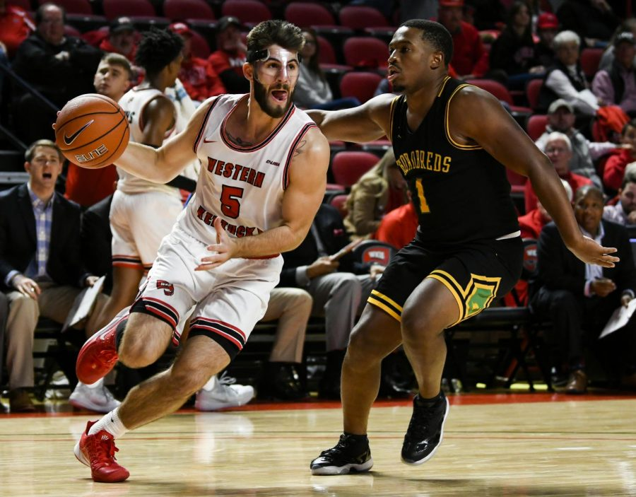 WKU+graduate+student+guard+Camron+Justice+%285%29+drives+inside+the+lane+during+the+exhibition+basketball+game+between+Kentucky+State+and+WKU+in+Diddle+Arena+on+November+2%2C+2019.+WKU+won+85-45.
