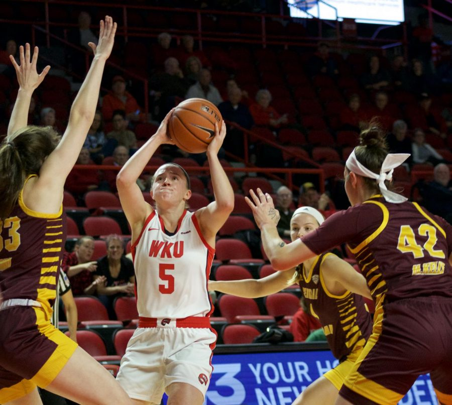 WKU senior guard Whitney Creech (5) pulls up for a shot in a crowd of Chippewas during the Lady Toppers game against Central Michigan in Diddle Arena on Sunday, Nov. 17 in Bowling Green.