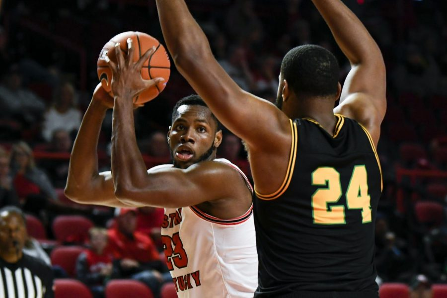 WKU+sophomore+center+Charles+Bassey+%2823%29+looks+for+a+pass+option+during+the+exhibition+basketball+game+between+Kentucky+State+and+WKU+in+Diddle+Arena+on+November+2%2C+2019.+WKU+won+85-45.