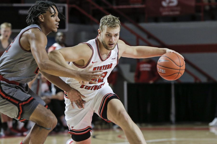WKU redshirt junior forward Carson Williams (22) dribbles the ball against Austin Peay on in E. A. Diddle Arena on Saturday, Nov. 9, 2019.