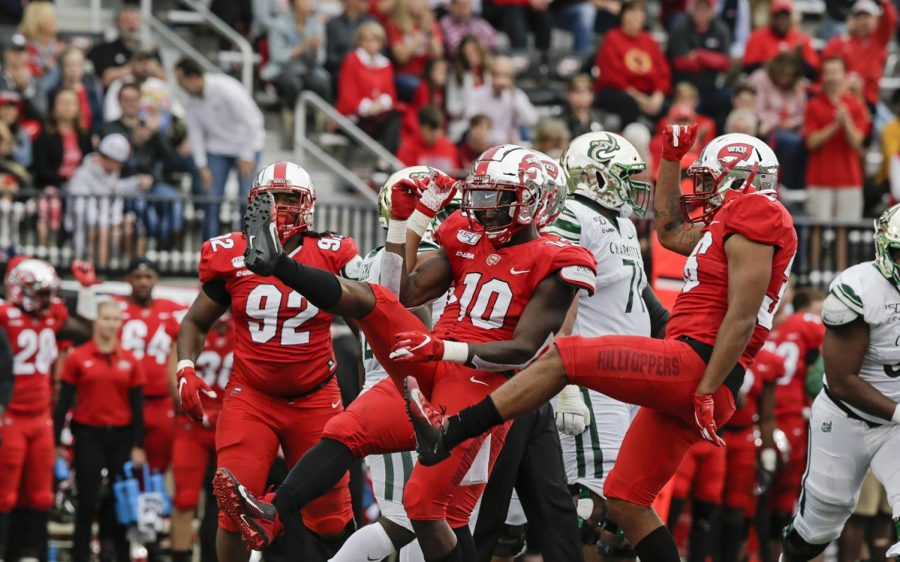 DeAngelo Malone (10) of Western Kentucky University's Hilltoppers celebrates with his teammates after a successful play at the game against the Charlotte 49ers on Saturday, Oct. 19, 2019, in Houchens-Smith Stadium, Bowling Green, Ky.