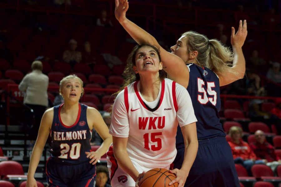 Junior forward Raneem Elgedawy (15) battles with Belmont senior forward Maddie Wright (55) during the Lady Toppers' game against Belmont in Diddle Arena on Wednesday, Nov. 13 in Bowling Green.