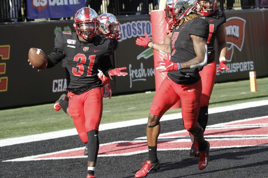 WKU junior defensive back Antwon Kincade (31) celebrates with junior defensive back Trae Meadows (7) after disrupting a passduring the Hilltoppers' game against Florida Atlantic in Houchens-Smith Stadium on Saturday, Nov. 2 in Bowling Green.
