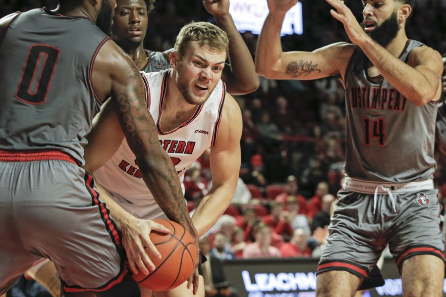WKU redshirt junior forward Carson Williams (22) tries to keep control of the ball against Austin Peay on in E. A. Diddle Arena on Saturday, Nov. 9, 2019.