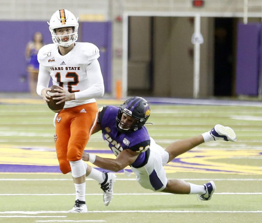 UNI's Elerson Smith trips up Idaho State quarterback Gunnar Amos during a Sept. 21 game in the UNI-Dome.