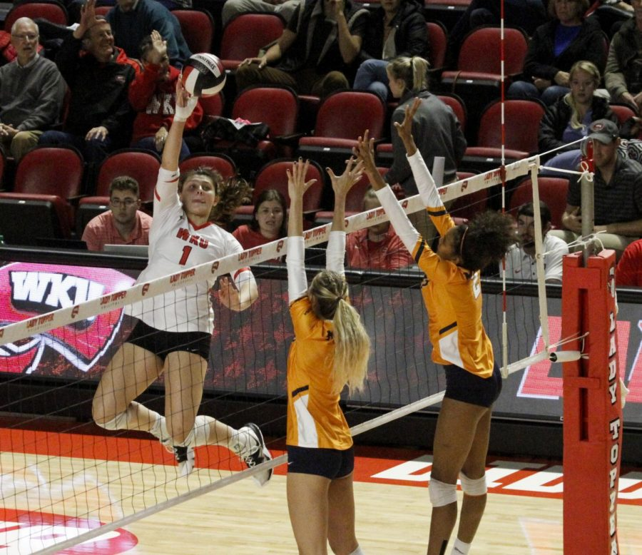Freshman Paige Briggs (1) plays defense as she jumps and attack the ball against two Miners during the Lady Toppers' game vs. UTEP in Diddle Arena on Nov. 1st, 2019. WKU won 3-0.