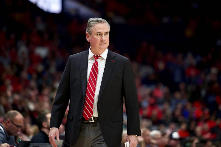 WKU head coach Rick Stansbury looks toward the floor while his team plays the Cardinals.The Cardinals defeated the Hilltoppers 71-54 in Bridgestone Arena on Sunday, Nov. 17, 2019, in Nashville.