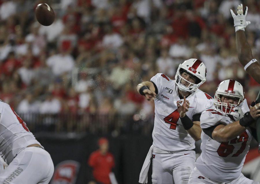 WKU quarterback Ty Storey (4) throws a pass against UAB at Houcens-Smith Stadium. WKU won 20-13.