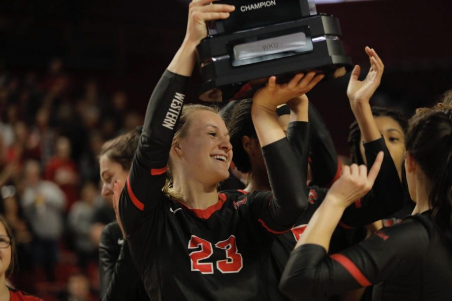 WKU senior Sophia Cerino (23) hoists the Conference USA regular season championship trophy following the Lady Toppers' match against Conference USA opponent Alabama-Birmingham in Diddle Arena on Nov. 16, 2019. The Lady Toppers swept the Blazers, 3-0.