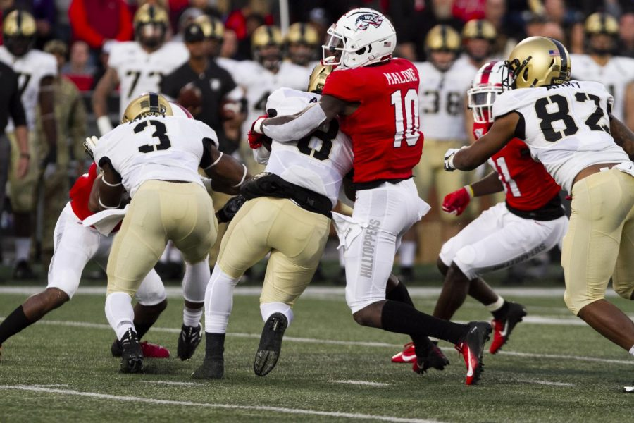 WKU defensive end DeAngelo Malone (10) tackles Army quarterback Kelvin Hopkins Jr. after a gain of 5 yards on Army