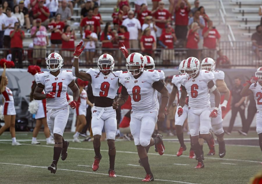 The WKU football team takes the field before playing against The UAB Blazers at Houcens-Smith Stadium. WKU won 20-13.