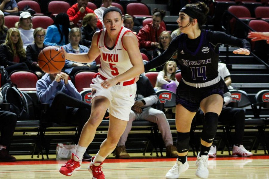 WKU+Guard+Whitney+Creech+%285%29+drives+to+basket+while+being+guarded+by+Kentucky+Wesleyan+forward+Keelie+Lamb+%2814%29.+The+Lady+Toppers+defeated+the+Panthers+72-60+in+Diddle+Arena+on+Thursday+October+31.