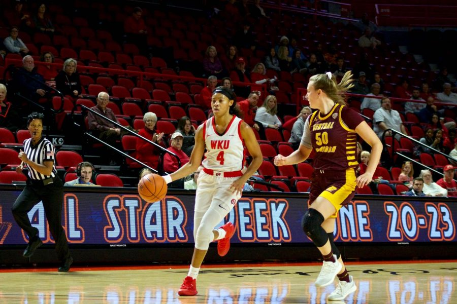 WKU+redshirt+senior+forward+Dee+Givens+%284%29+drives+the+ball+down+the+floor+with+Chippewa+junior+forward+Kyra+Bussell+%2850%29+trailing+her+during+the+Lady+Toppers%27+game+against+Central+Michigan+in+Diddle+Arena+on+Sunday%2C+Nov.+17+in+Bowling+Green.
