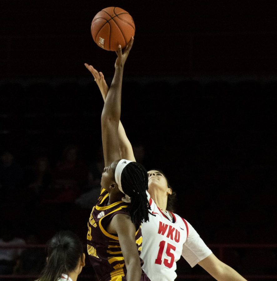 WKU forward Raneem Elgedawy jumps for the tip to open the game. The Lady Toppers defeated the Chippewas 93 - 58 in Diddle Arena on Sunday, November 17 2019.