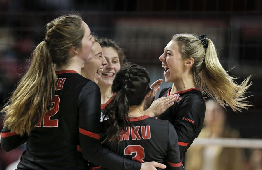 WKU sophomore Katie Isenbarger (20) celebrates after a play with her teammates during the WKU's senior day game against the UAB Blazers at E.A. Diddle Arena on Saturday, Nov. 16, 2019. WKU swept UAB 3-0 to finish the regular season with a record of 28 wins and one loss.