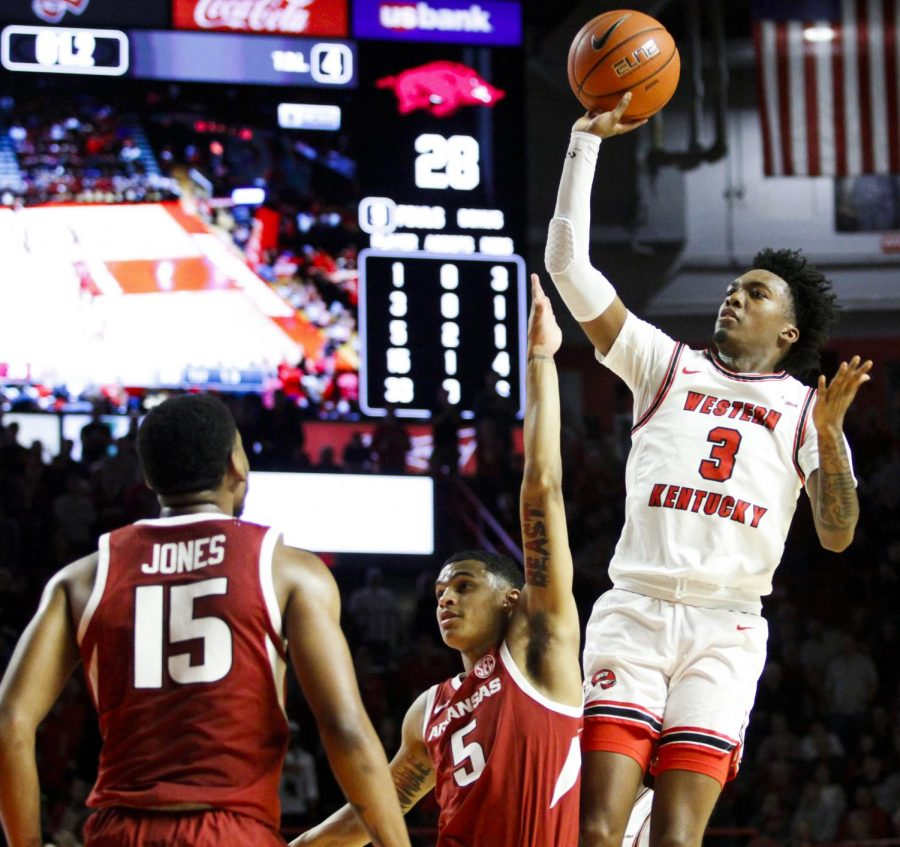 WKU guard Jordan Rawls (3) shoots the floater over Arkansas guard Jalen Harris (5). The Hilltoppers defeated the Razorbacks 86 - 79 in Diddle Arena on Saturday, December 7, 2019.