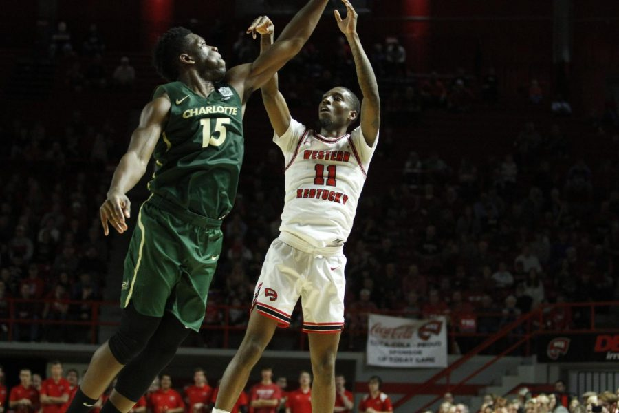 Junior+guard+Taveion+Hollingsworth+%2811%29+pull+up+to+shoot+over+Charlotte+graduate+forward+Amidou+Bamba+%2815%29%C2%A0during+the+WKU+Hilltoppers%27+80-63+win+over+the+Charlotte+49ers+on+Saturday%2C+Jan.+18%2C+2020+in+Diddle+Arena.