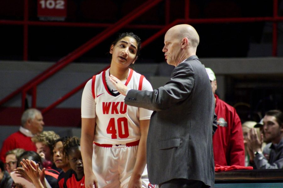 Sophomore guard Meral Abdelgawad (40) receives some feedback from WKU women's basketball head coach Greg Collins during the Lady Toppers' game against Belmont in Diddle Arena on Wednesday, Nov. 13 in Bowling Green.