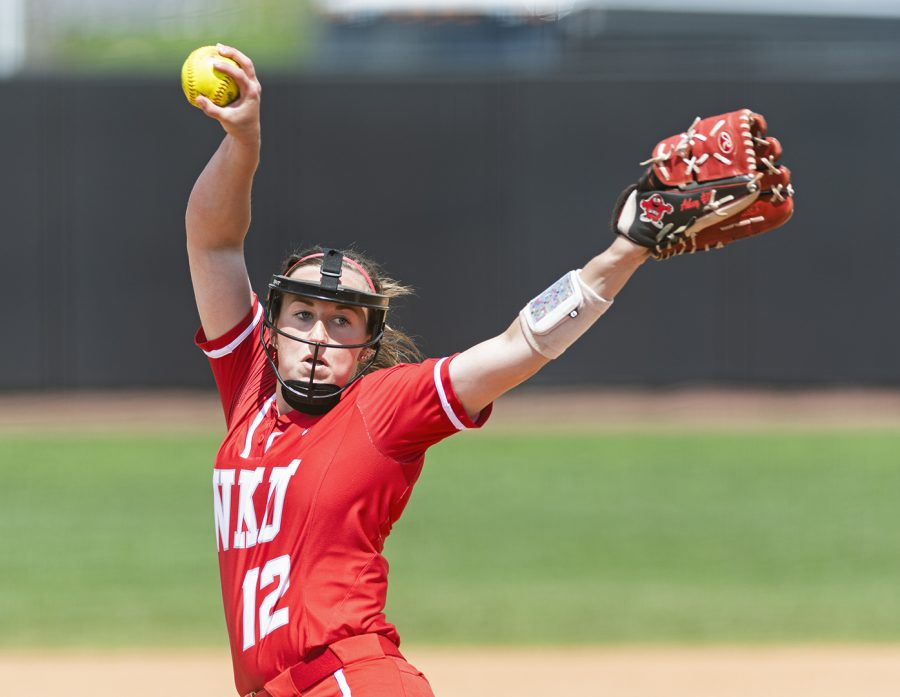 WKU pitcher Kelsey Aikey (12) winds up to pitch against North Texas on April 14. Aikey pitched all five innings of the 8-0 victory, allowing only one hit in 104 pitches. CHRIS KOHLEY/HERALD