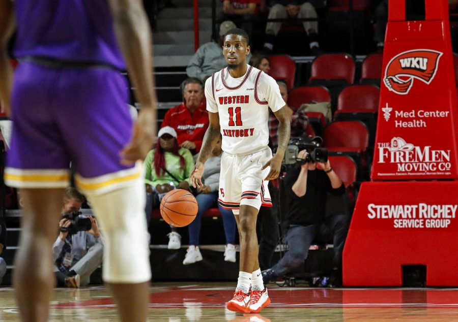 WKU+guard+Taveion+Hollingsworth+%2811%29+brings+the+ball+up+court+during+the+game+against+Tennessee+Tech+on+Tuesday%2C+Nov.+5%2C+2019.+Hollingsworth+scored+his+1%2C000th+point+becoming+the+50th+player+to+accomplish+this+goal+in+program+history.+The+Hilltoppers+defeated+the+Golden+Eagles+76-64.