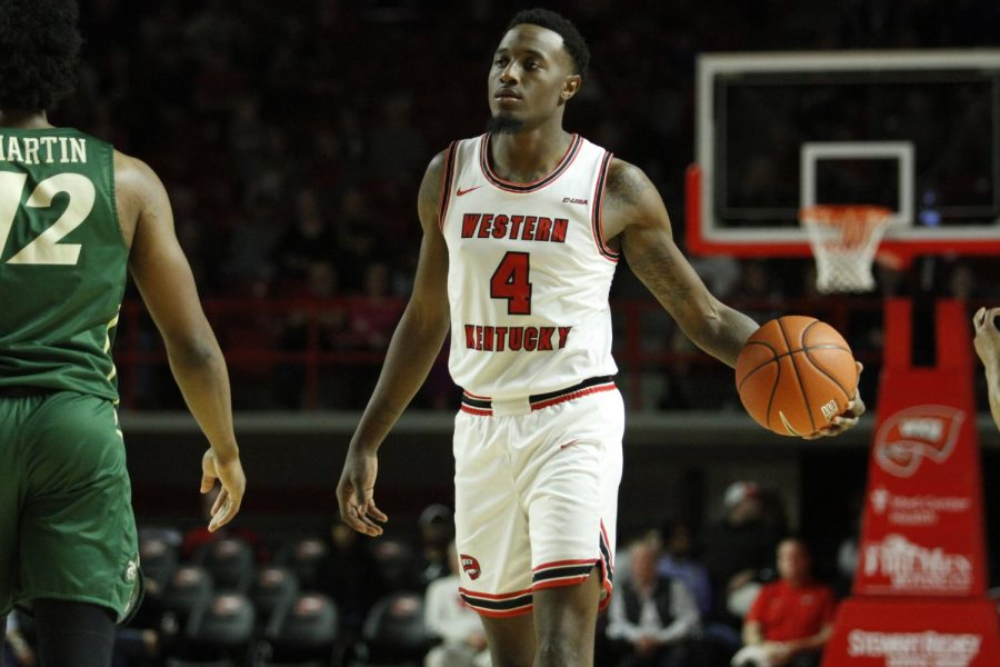 Junior guard Josh Anderson (4) brings the ball up the floor during the WKU Hilltoppers' 80-63 win over the Charlotte 49ers on Saturday, Jan. 18, 2020 in Diddle Arena.