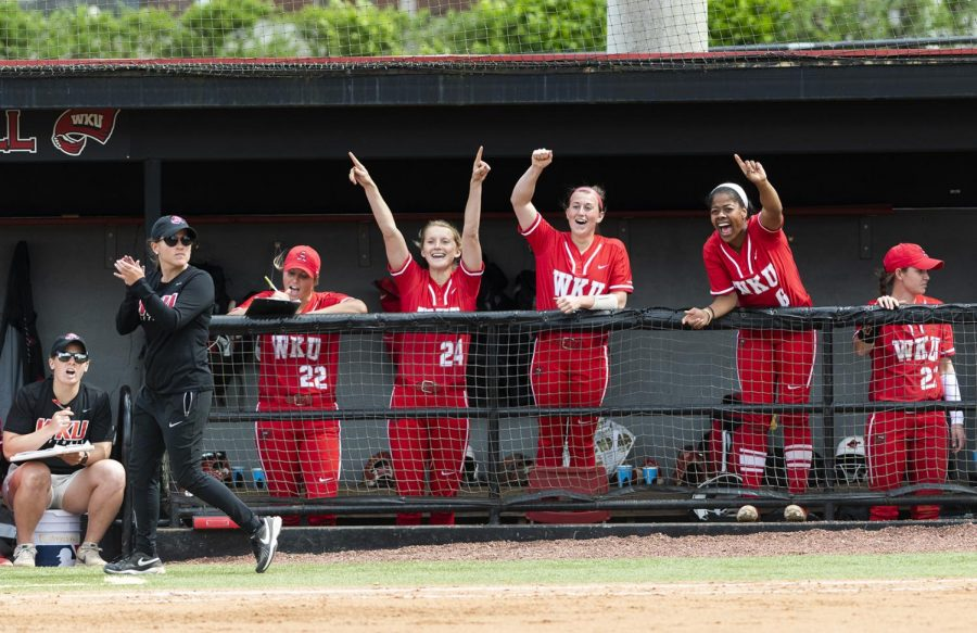 The WKU softball team cheers from the dugout after a successful bunt from Kennedy Sullivan against North Texas on Sunday. The Hilltoppers went on to win 8-0, advancing their conference record to 12-3.