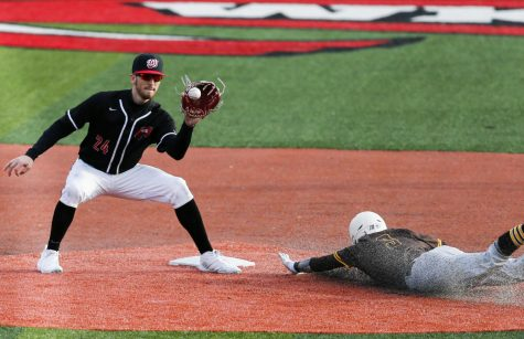 WKU's Kevin Lambert (24) tags second base before Valparaiso catcher Jake Kapers (3) can reach it at Nick Denes Field on Feb. 15, 2020. WKU won 9-3.