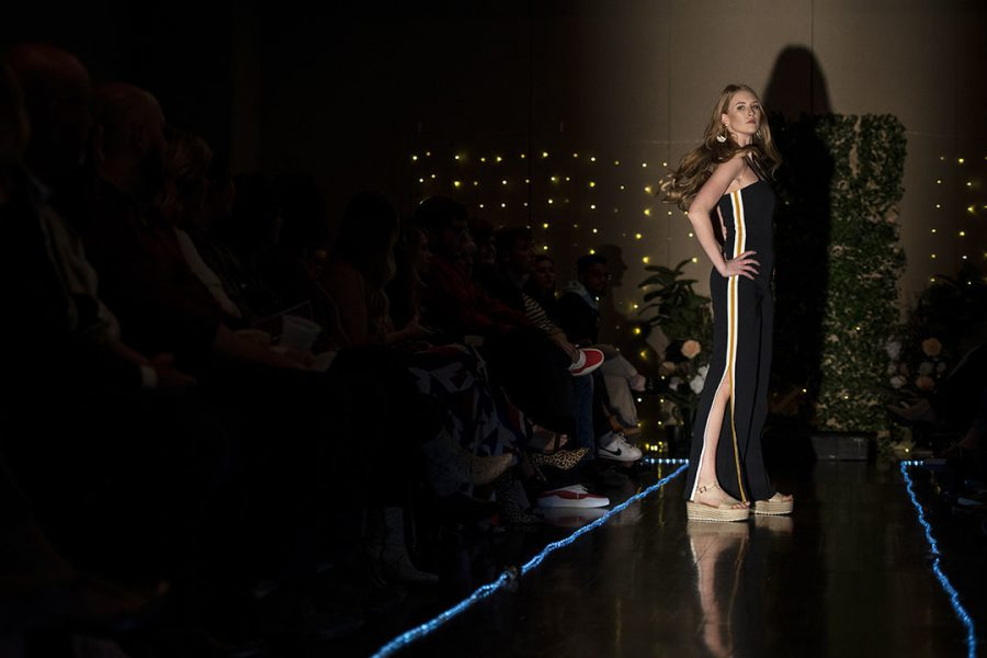 Macy+Preston+takes+her+second+walk+down+the+runway+wearing+a+striped+jumpsuit+styled+for+a+future+career+as+a+boutique+owner.+Last+years+fashion+show%2C+titled+%E2%80%9CPicture+This%3A+A+Snapshot+into+your+Future+Career%E2%80%9D%2C+was+meant+to+show+people+options+on+how+they+could+dress+for+a+certain+career+field.