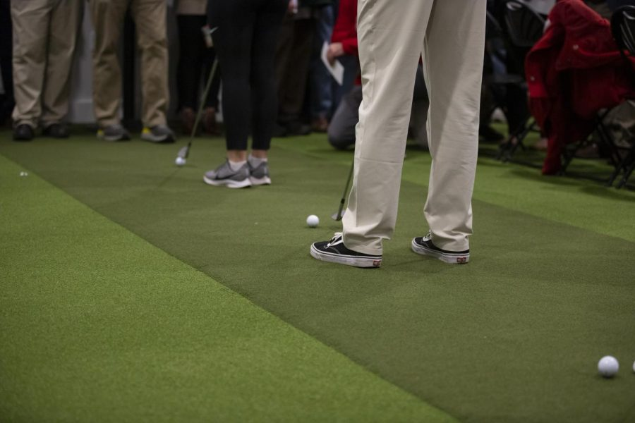 Members of the WKU golf team line up in preparation for the first swing in their new facility. The building offers players a chance to hone their game with a wide array of new technology.