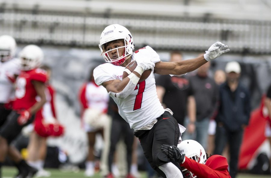 WKU+wide+receiver+Jahcour+Pearson+%287%29+is+brought+down+by+defensive+back+Ta%27Corian+Darden+%2815%29+during+the+Red+vs.+White+Spring+Game+on+April+13.+The+White+team+went+on+to+defeat+the+Red+team+by+a+score+of+28-21.