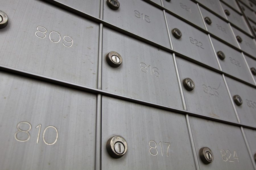 """Mailboxes at The Crown apartments hang empty after tenants stopped receiving mail after the United States Postal Service reclassified apartment complexes to dormitories. Tenants like Nicole Cortez and her roommates took matters into their own hands. """"We've had to get a P.O. Box just so we can get our mail,"""" Cortez said."""